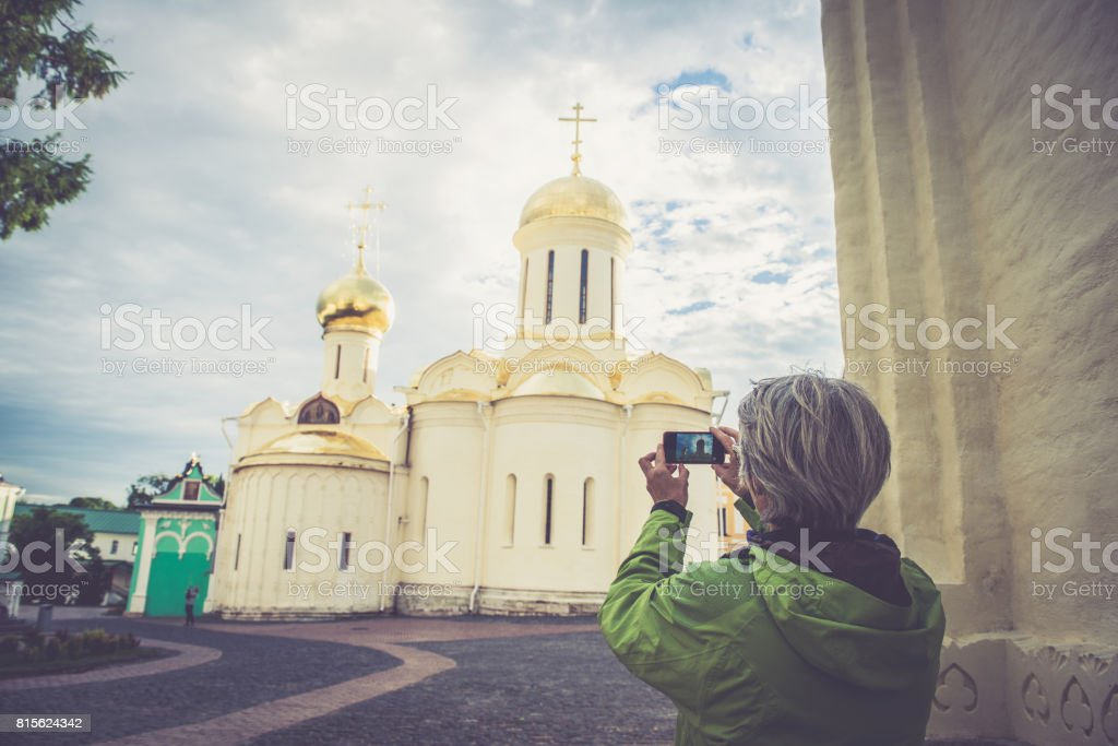 Mature Woman Photographing Church in Sergiyev Posad, city part of Golden  Ring Cluster, Russia - Stock image .