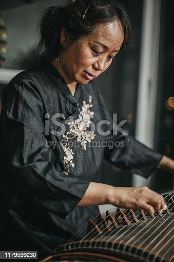 Mature Woman Playing Harp