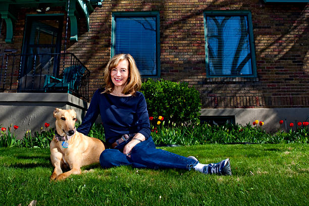 Mature Woman Portrait With Her Dog stock photo
