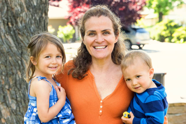 Mature woman posing with her children stock photo