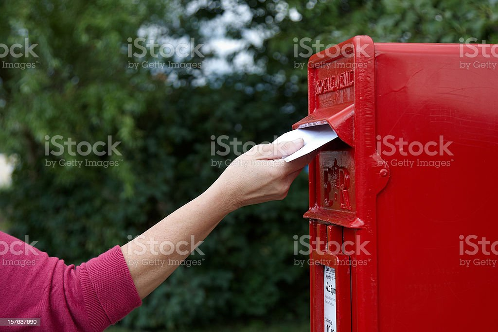 Mature woman posting a letter royalty-free stock photo