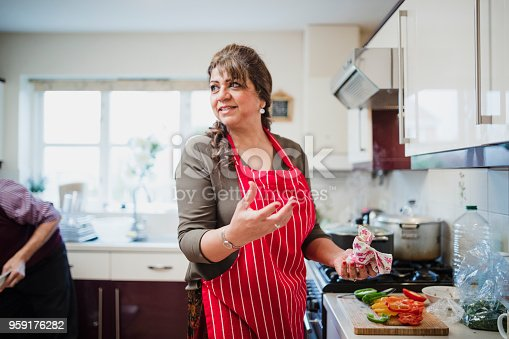 istock Mature Woman Preparing Food for Dinner Party 959176282