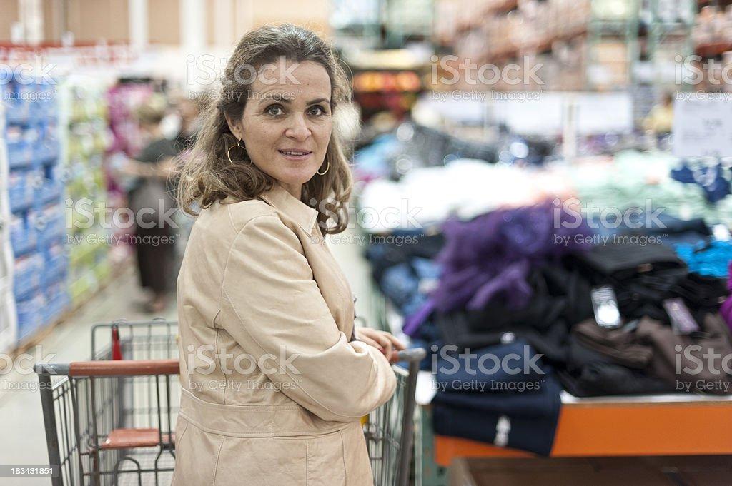 Mature woman pushing her shopping cart stock photo