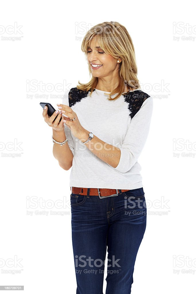 Mature woman reading text message on cell phone stock photo