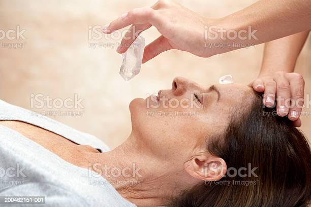 Mature Woman Receiving Crystal Healing Treatment Eyes Closedcloseup Stock Photo - Download Image Now