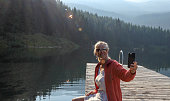 She takes selfie pic. Lost Lake, Whistler, BC
