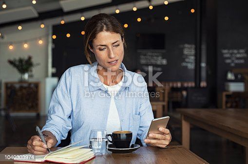 istock Mature woman relaxing at cafe 1040303974