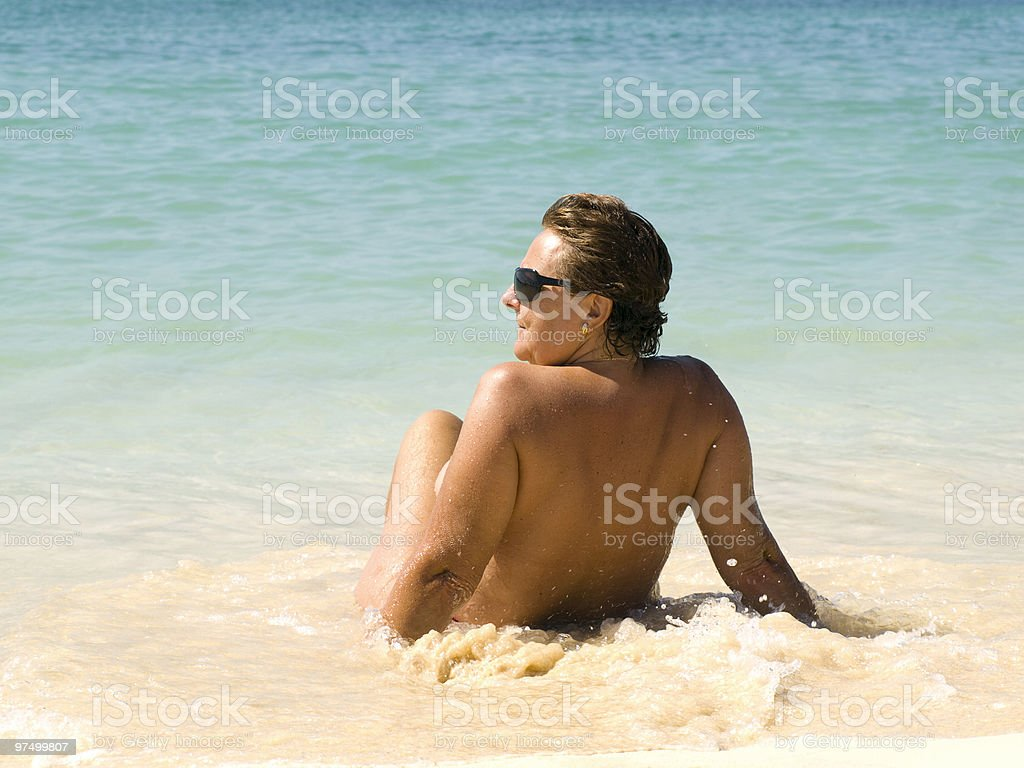 Mature woman relaxing in the beach royalty-free stock photo