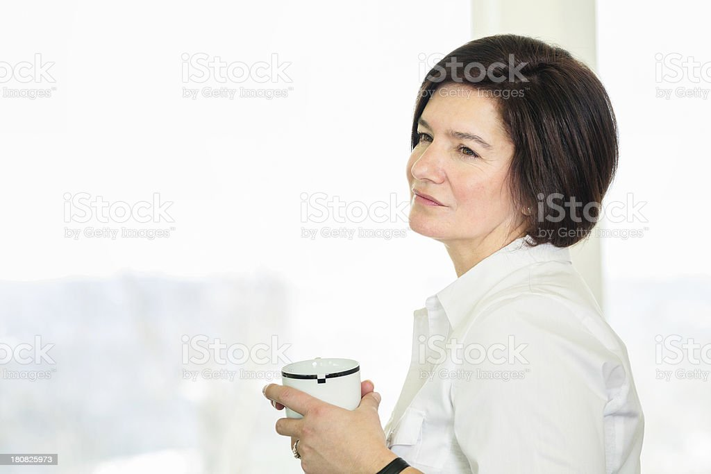 Mature woman relaxing with cup of coffee royalty-free stock photo