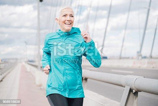 istock Mature woman running 958918638