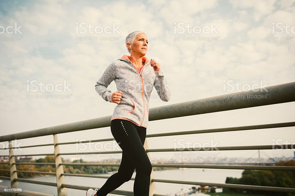 Mature Woman Running The City stock photo
