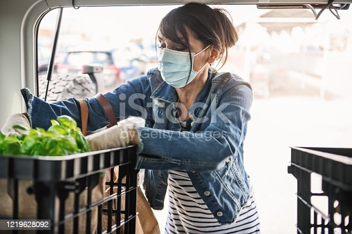 Mature woman shopping grocerie.  Quebec, Canada
