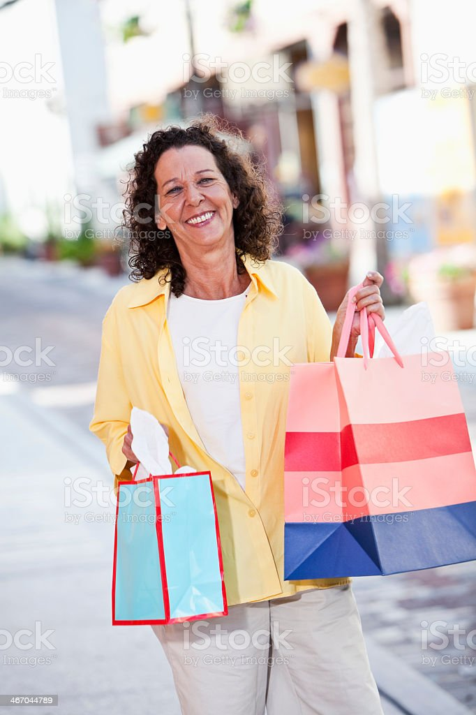 Mature woman shopping stock photo
