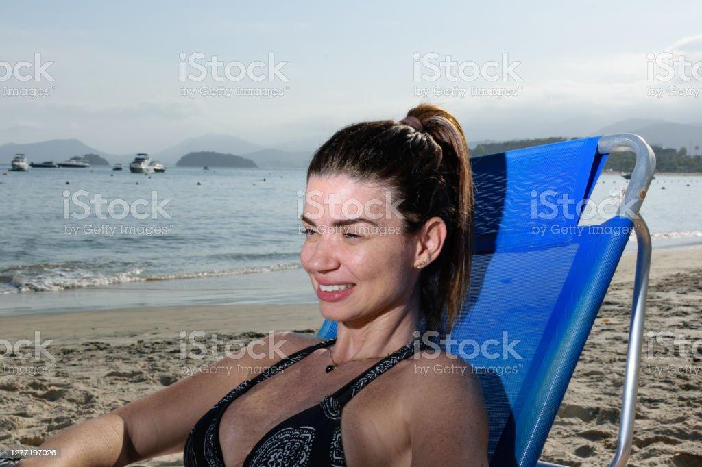 Beach pics mature Dubio Bikinis