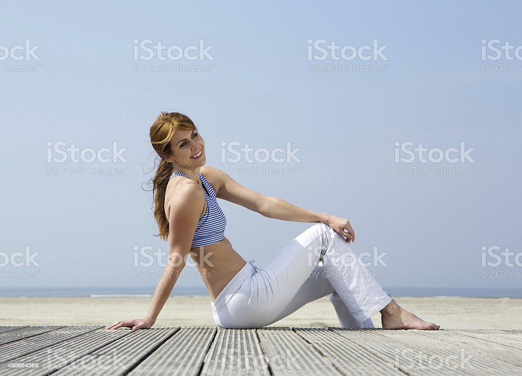 Mature woman smiling at the beach royalty-free stock photo