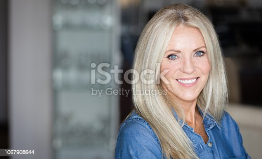 istock Mature Woman smiling at the camera 1067908644