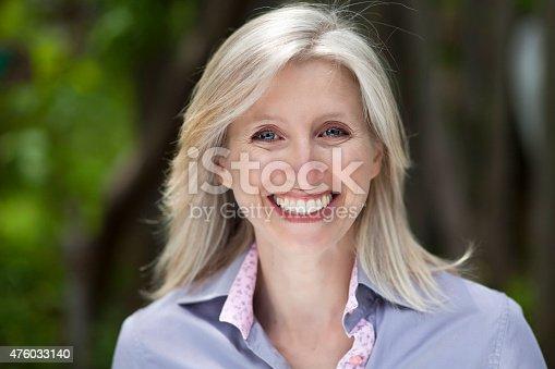 istock Mature Woman smiling at the camera 476033140