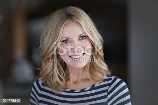 istock Mature Woman smiling at the camera 504779842