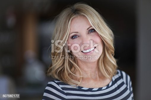 istock Mature Woman smiling at the camera 507582172