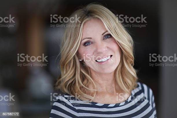Mature woman smiling at the camera picture id507582172?b=1&k=6&m=507582172&s=612x612&h=meupw1qpxdoxnn7cnq58tdniddjycc4heomgxpx1vek=