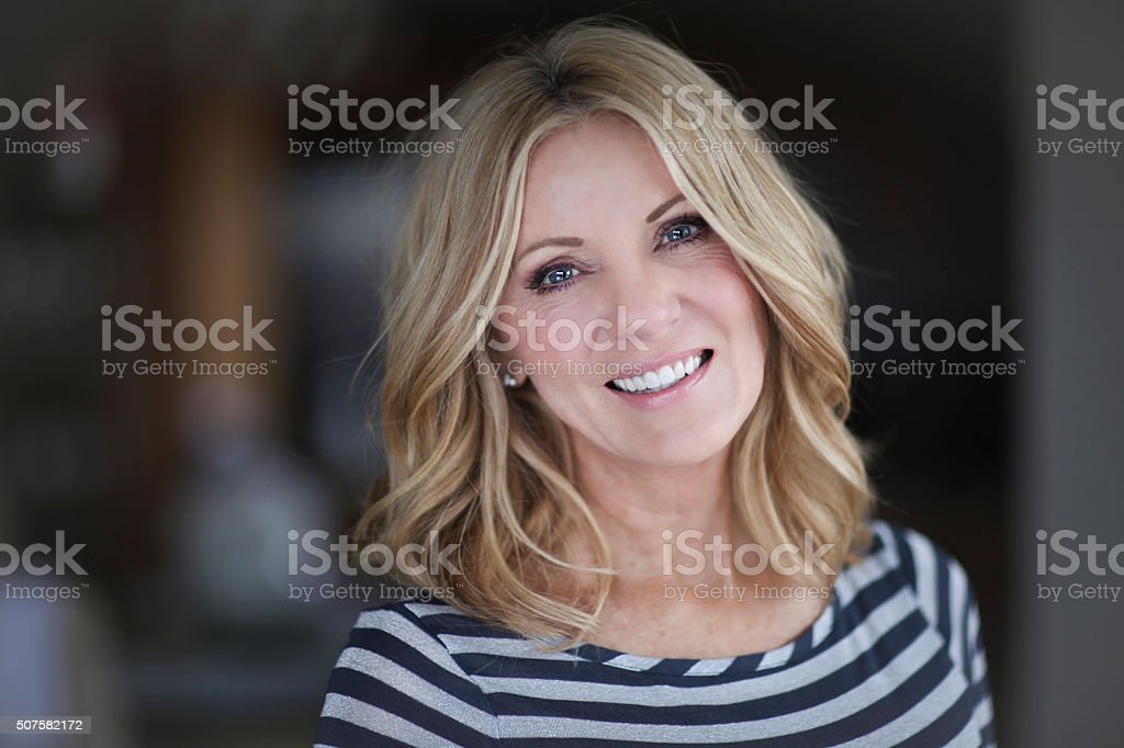 Mature Woman smiling at the camera stock photo