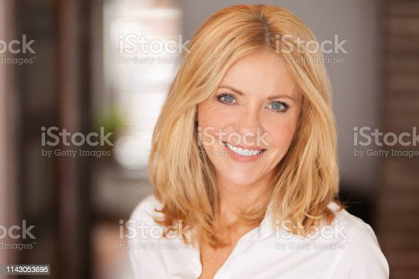 Mature Woman Smiling At The Camera She Relaxing At Home Beautiful Stock Photo - Download Image Now