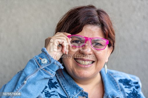 825083310 istock photo Mature woman smiling looking at the camera 1075573308