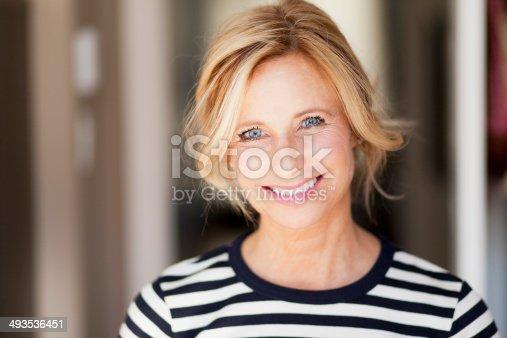 istock Mature woman smiling 493536451