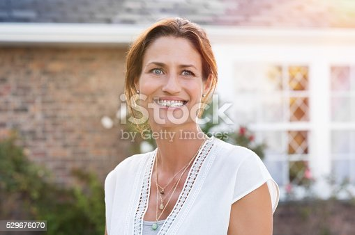 istock Mature woman smiling 529676070