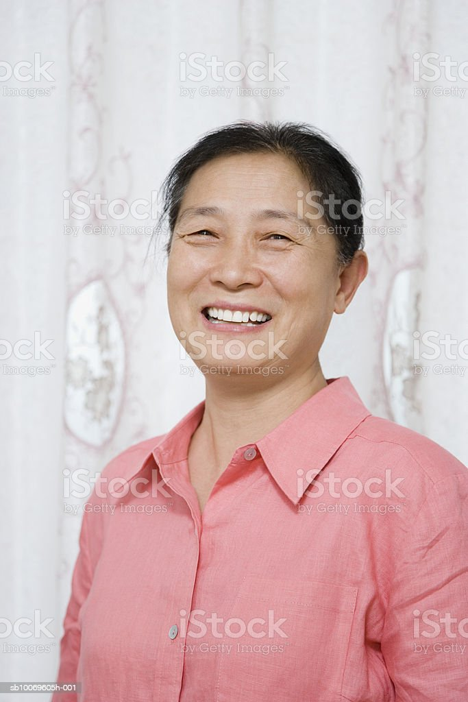 Mature woman smiling, portrait 免版稅 stock photo