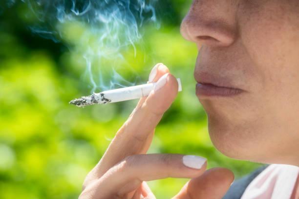 Mature woman smoking stock photo