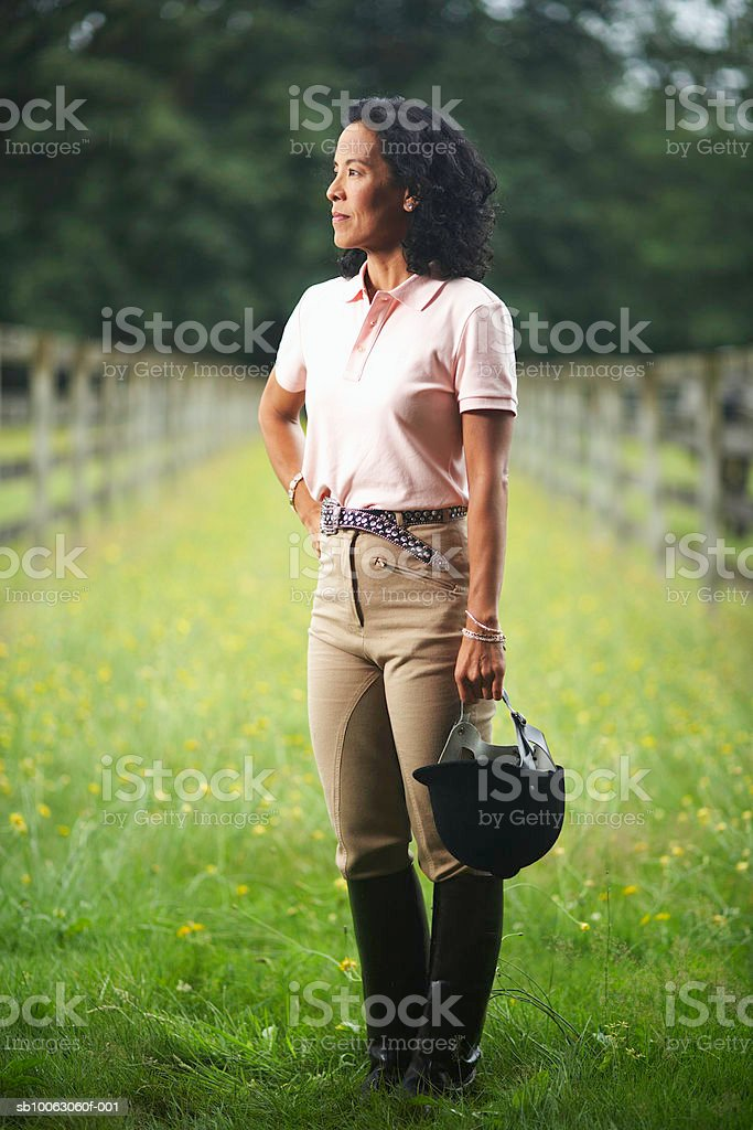 Mature woman standing in field stock photo