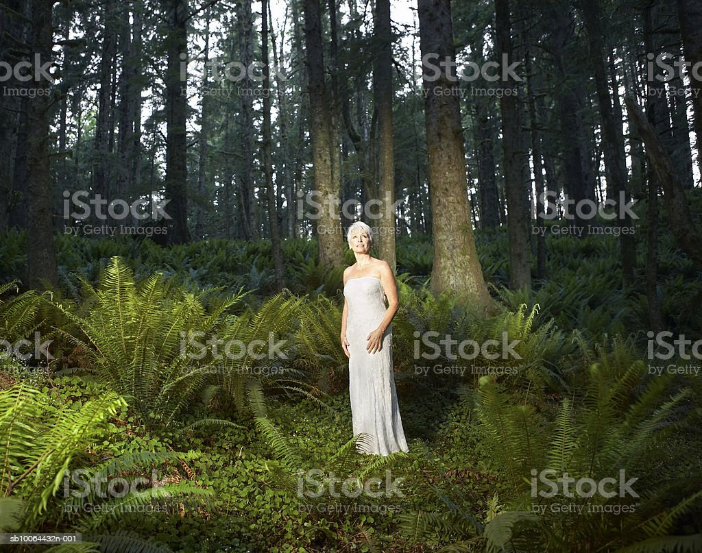 Mature woman standing in forest royalty-free stock photo