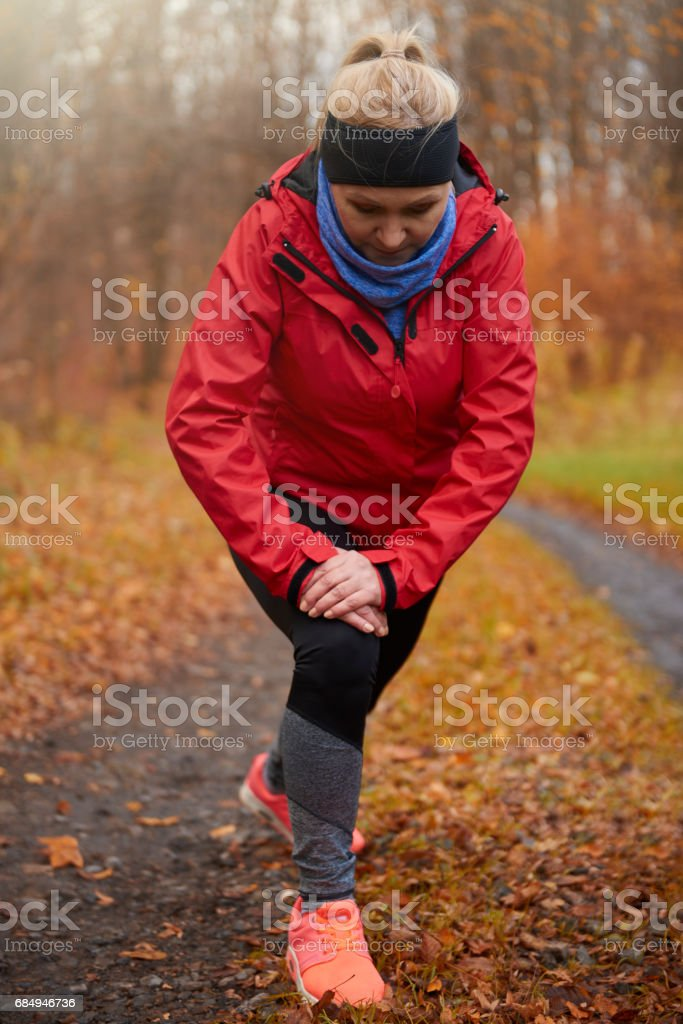 Mature woman stretching before exercise Lizenzfreies stock-foto