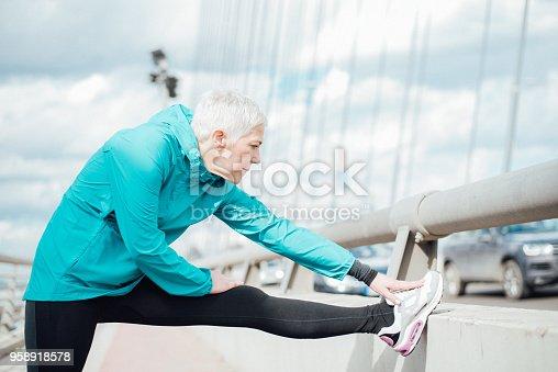 istock Mature woman stretching 958918578