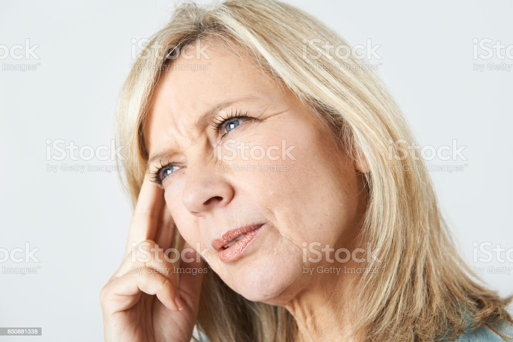 Mature Woman Suffering From Memory Loss stock photo