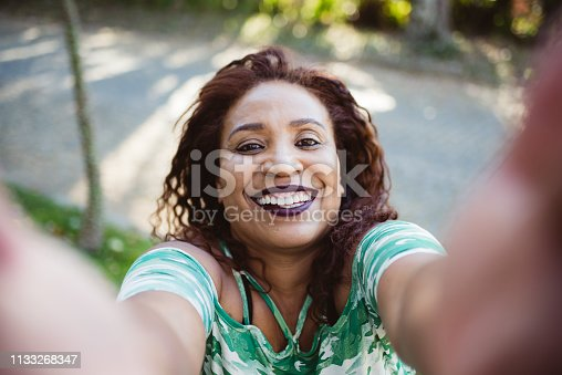 istock Mature woman taking selfie 1133268347
