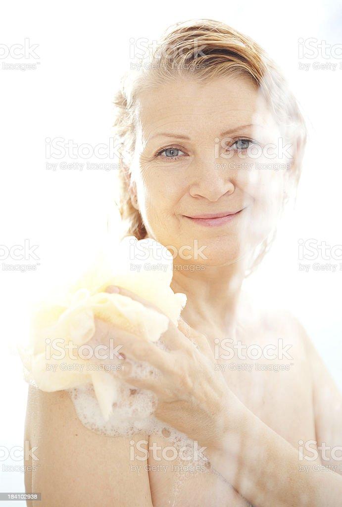 Mature woman taking shower