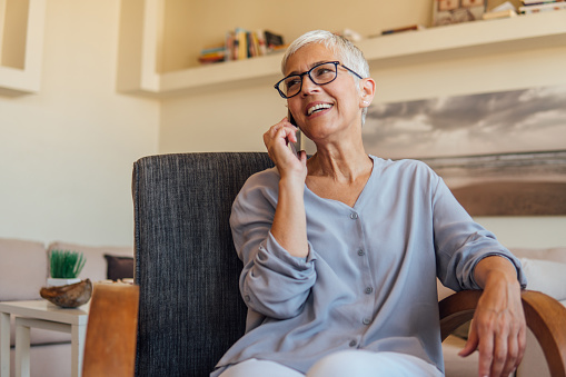 istock Mature woman talking on mobile phone 1042049562