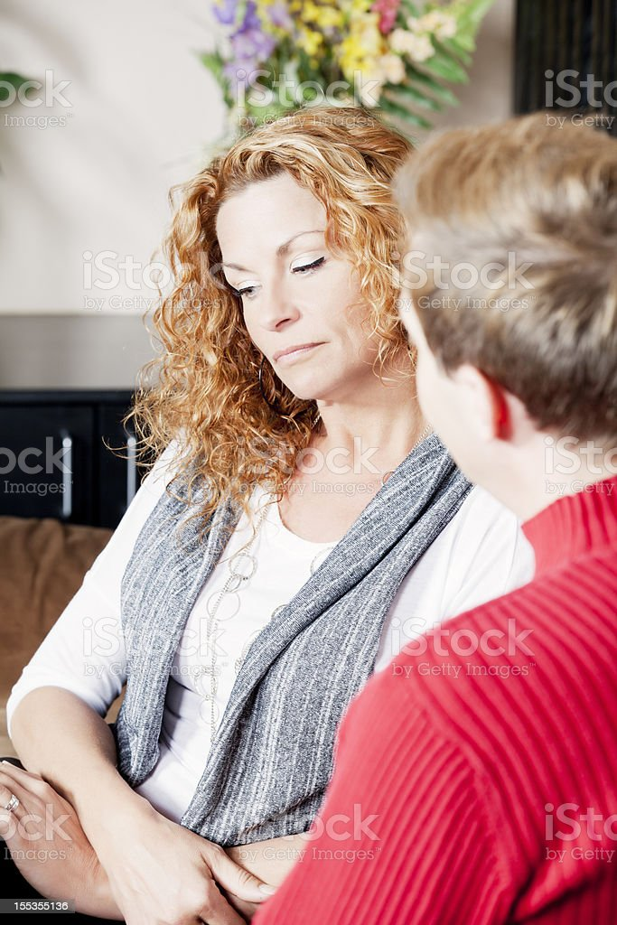 Mature woman talking to a man royalty-free stock photo