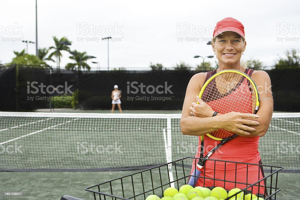 mature woman tennis coach stock photo