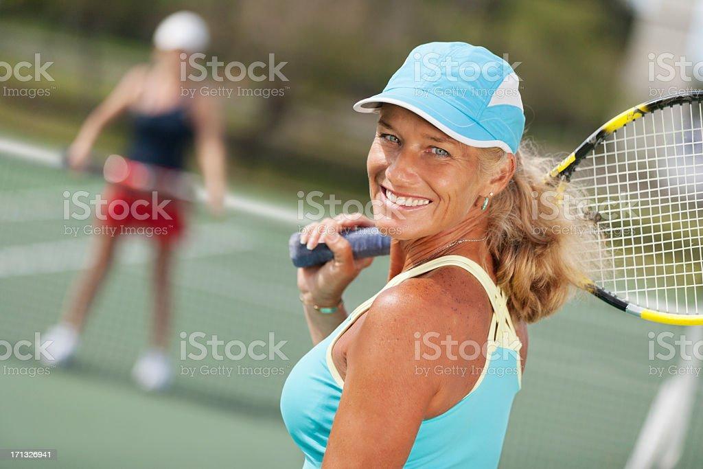 Mature woman tennis portrait stock photo