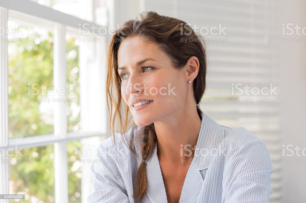 Mature woman thinking stock photo