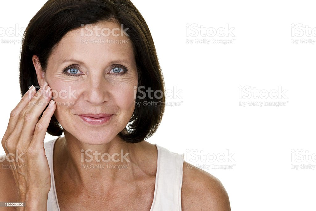 Mature woman touching her face stock photo
