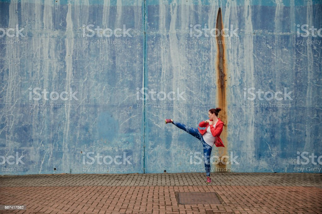 Mature Woman trianing Outdoors stock photo