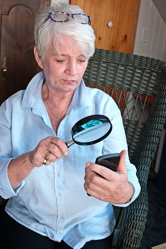 https://media.istockphoto.com/photos/mature-woman-uses-a-magnifying-glass-with-a-cell-phone-picture-id621390734?k=6&m=621390734&s=170667a&w=0&h=2lHmdqJ2wVazf-_3b-wXYlmqd1ybUs0kMjka4dFVJhE=