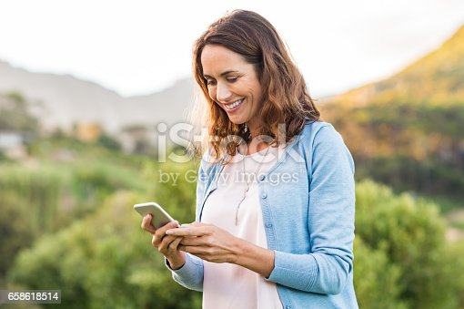 istock Mature woman using cellphone 658618514