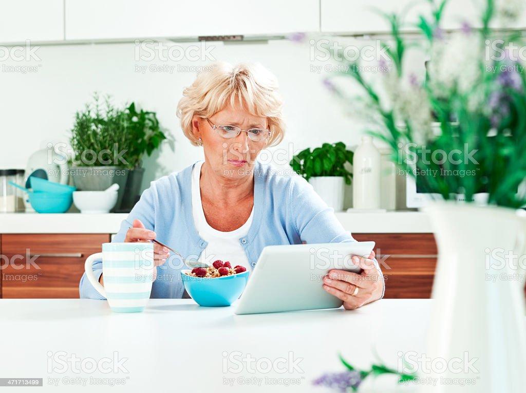 Mature woman using digital tablet royalty-free stock photo