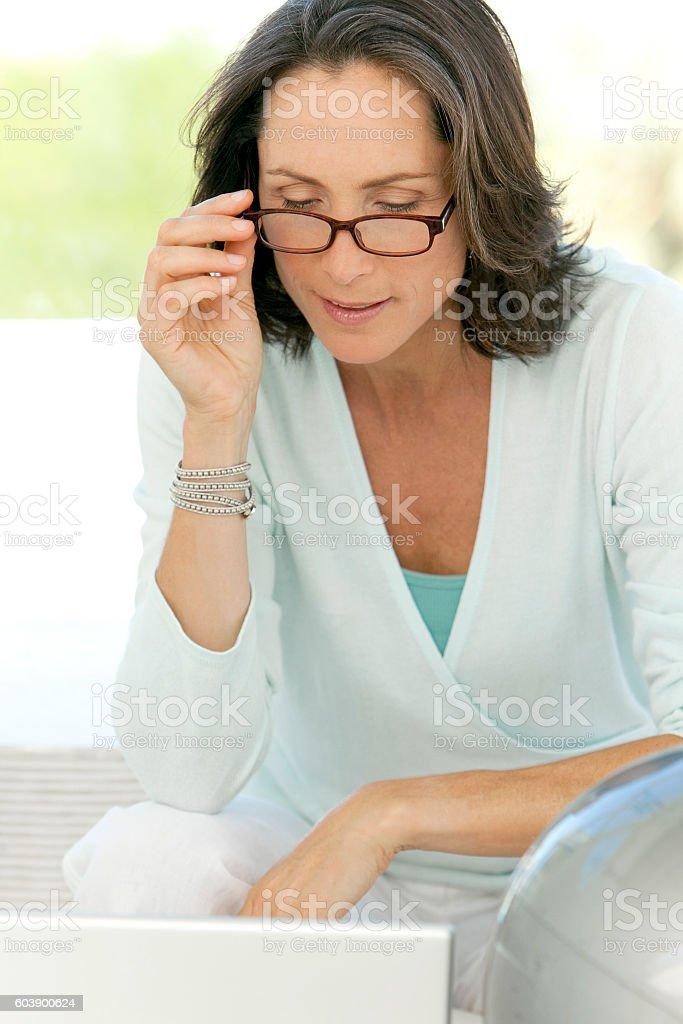 Mature woman using glasses stock photo