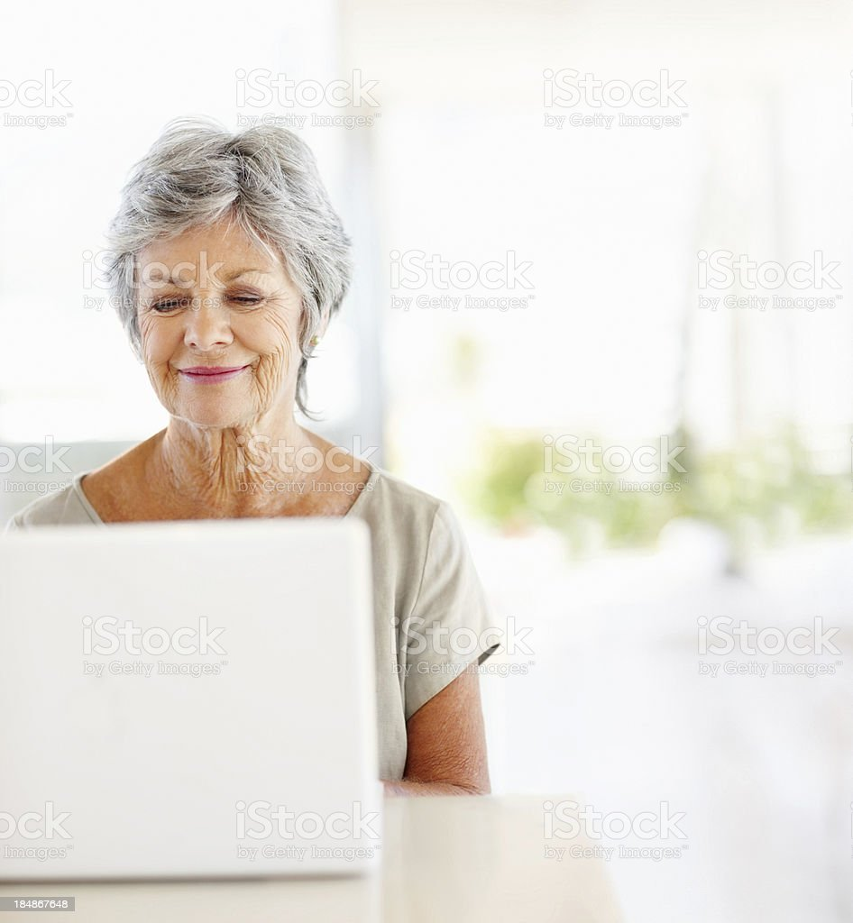 Mature woman using the internet stock photo